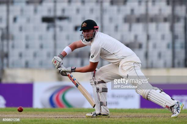 Australian cricketer Matt Renshaw plays a shot during the first day of the first Test cricket match between Bangladesh and Australia at the...