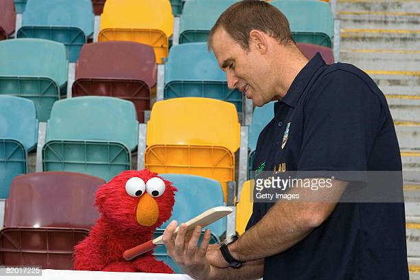 Australian cricketer Matthew Hayden and Seasame Street's Elmo pose as they launch in2CRICKETcomau the new entry level program for boys and girls at...