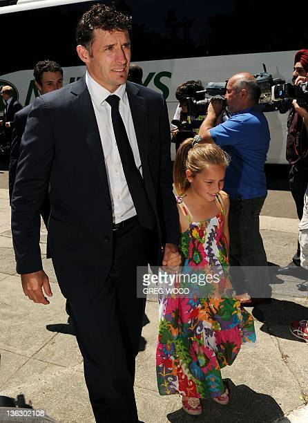 Australian cricketer Michael Hussey arrives with his daughter Jasmine for an afternoon tea put on by Australian Prime Minister Julia Gillard at...
