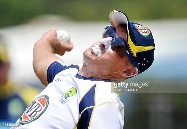 Australian cricketer Michael Hussey delivers a ball during a practice session at the Arnos Vale Ground in Kingstown on March 17 2012 Australia will...
