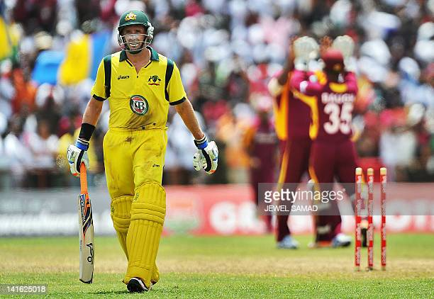 Australian cricketer Michael Hussey leaves the field after being dismissed during the third-of-five One Day International matches between West Indies...