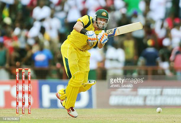 Australian cricketer Michael Hussey plays a shot during the third-of-five One Day International matches between West Indies and Australia at the...