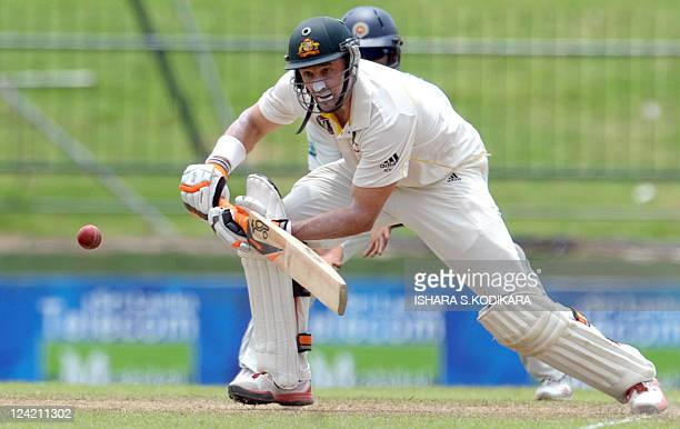 Australian cricketer Michael Hussey plays a shot during the second day of the second Test match between Australia and Sri Lanka at The Pallekele...