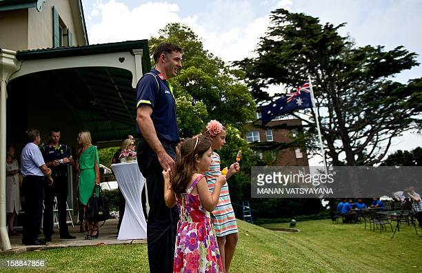 Australian cricketer Michael Hussey poses with his daughters Molly and Jasmin during an afternoon tea at Kirribilli House in Sydney on January 1 2013...