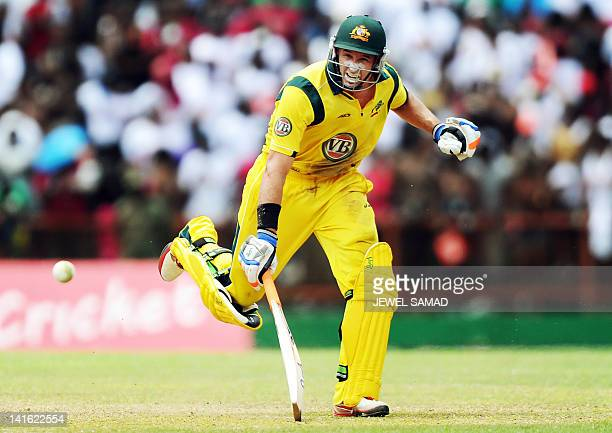 Australian cricketer Michael Hussey takes a run during the third-of-five One Day International matches between West Indies and Australia at the Arnos...