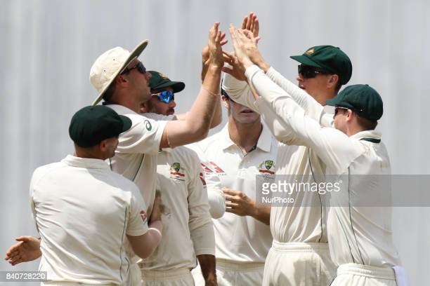 Australian cricketer Nathan Lyon reacts after the dismissal of the Bangladeshi cricket captain Mushfiqur Rahim during the third day of the first Test...