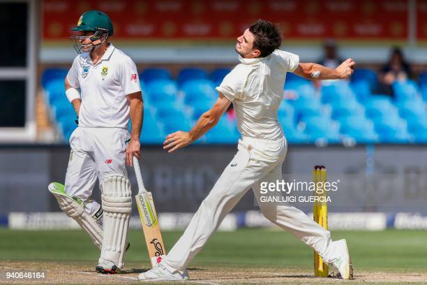 Australian cricketer Pat Cummins delivers a ball to South African batsman Aiden Markram on the third day of the fourth Test cricket match between...