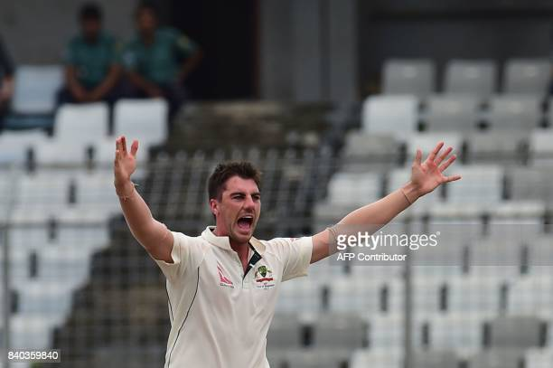 Australian cricketer Pat Cummins unsuccessfully appeals for a leg before wicket decision against Bangladeshi cricketer Tamim Iqbal during the third...