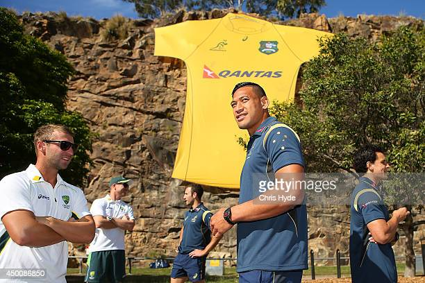 Australian Cricketer Phil Hughes talks with Australian Wallabies Israel Folau during a joint Wallabies/Cricket Australia media session at Kangaroo...