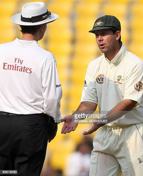 Australian cricketer Ricky Ponting gestures as he interacts with umpire Billy Bowden of New Zealand on the fourth day of the fourth and final test...