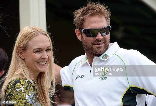 Australian cricketer Ryan Harris smiles along with his partner during a New Year's Day reception hosted by the Australian Prime Minister Tony Abbott...