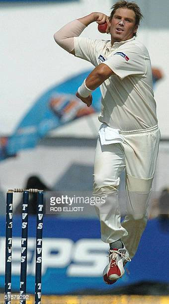 Australian cricketer Shane Warne leaps in the air to bowl a delivery on the second day of the third Test match at The Vidarbha Cricket Association...