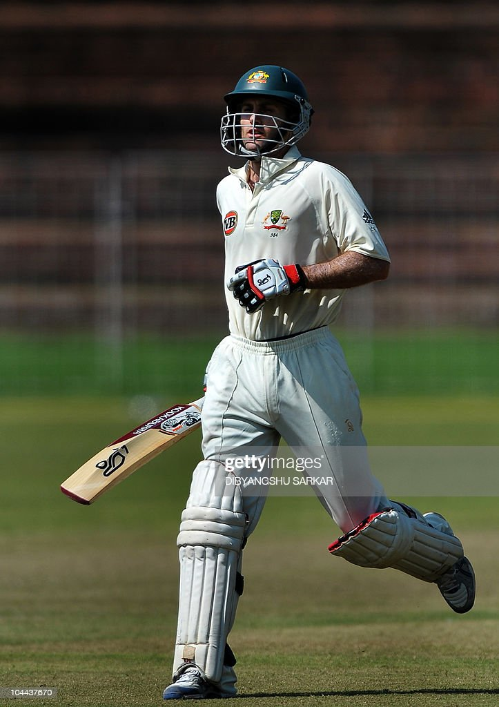 Australian cricketer Simon Katich completes a run to make his century during the first day of the threeday practice match against the Indian Board...