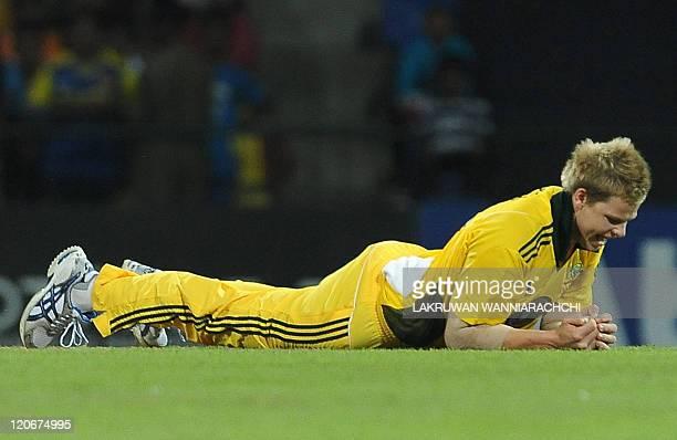 Australian cricketer Steven Smith takes a catch to dismiss Sri Lankan cricketer Dinesh Chandimal during the second Twenty20 match between Sri Lanka...