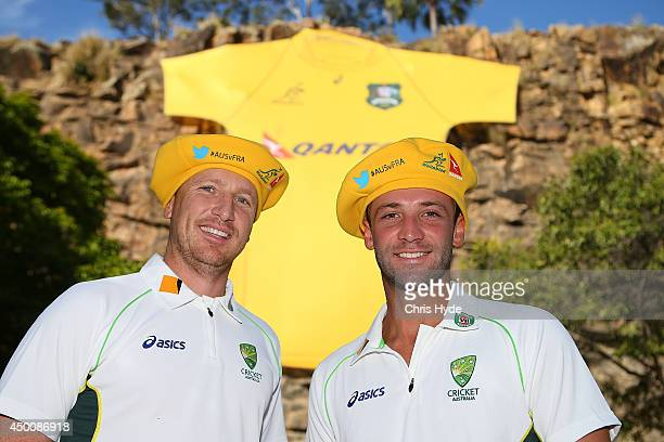 Australian Cricketers Brad Haddin and Phil Hughes pose during a joint Wallabies/Cricket Australia media session at Kangaroo Point Cliffs on June 5...