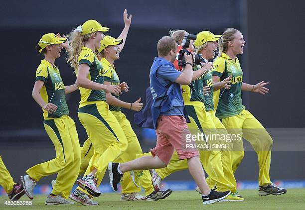 Australian cricketers celebrate their victory over England during the ICC Women's World Twenty20 final cricket match between Australia and England at...