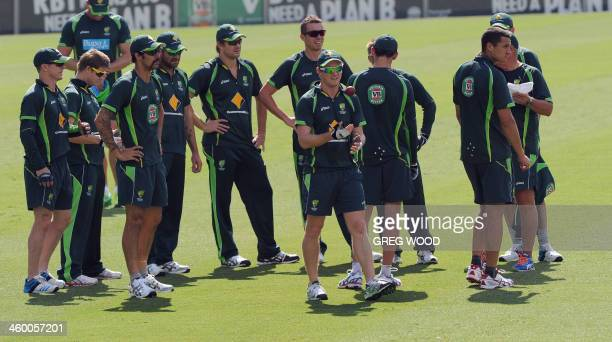 Australian cricketers gather on the field during a training session at the Sydney Cricket Ground on January 2 2014 England are struggling to avoid a...
