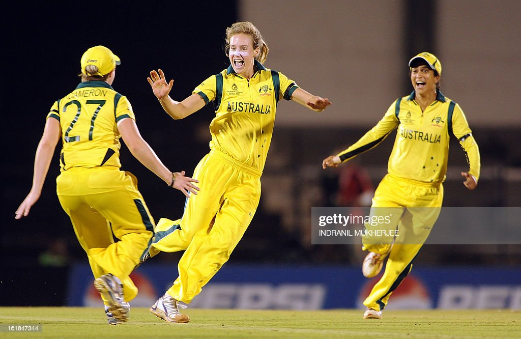 Australian cricketers Jess Cameron and Lisa Sthalekar (R) celebrate with teammate Elysse Perry the wicket of unseen West Indies cricketer Stafanie Taylor during the final match of the ICC Women's World Cup 2013 between Australia and West Indies at the Cricket Club of India's Brabourne stadium in Mumbai on February 17, 2013. AFP PHOTO/Indranil MUKHERJEE