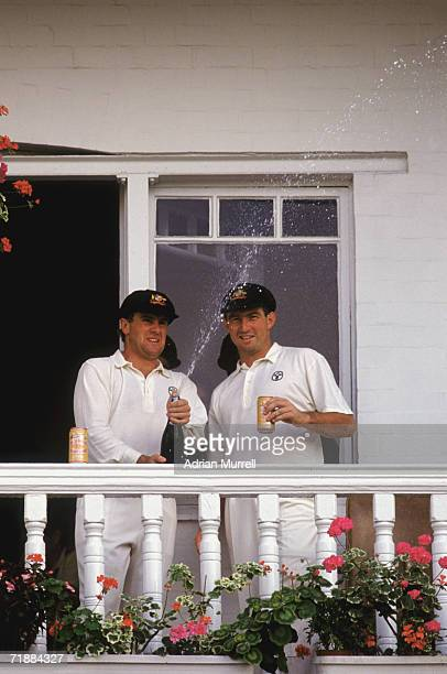Australian cricketers Mark Taylor and Geoff Marsh celebrate their stand of 329 for the first wicket during the 5th Test in the Ashes series at Trent...