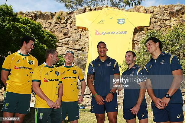 Australian Cricketers Mitchell Starc Phil Hughes and Brad Haddin join Australian Wallabies Israel Folau Nic White and Matt Toomua during a joint...