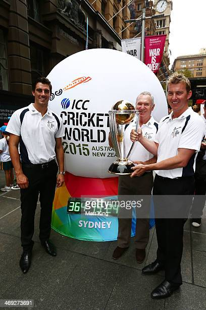 Australian cricketers Pat Cummins and Brett Lee and former Australian cricket captain Allan Border pose with the ICC Cricket World Cup during the...