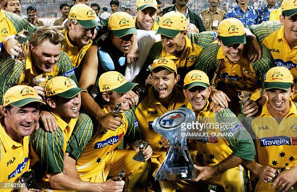 Australian cricketers pose with the trophy after defeating India in the final of the triseries one day international at the Eden Garden cricket...