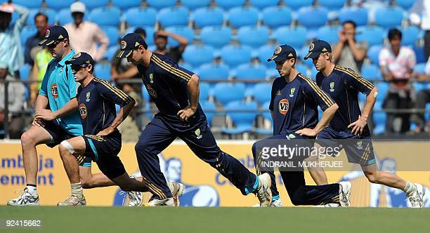 Australian cricketers warm-up before the start of the second One Day International match between India and Australia at the Vidarbha Cricket...