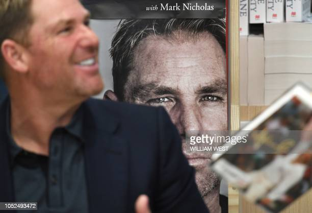 Australian cricketing great Shane Warne chats with a customer during a book signing event for his new autobiography titled No Spin in Melbourne on...
