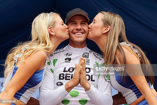 Australian cyclist Adam Hansen of the LottoBelisol team celebrates on stage after he was presented with the King of the Mountain jersey after Stage...