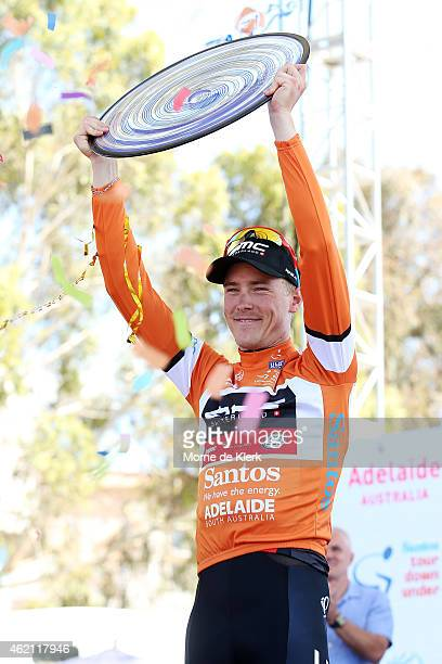 Australian cyclist and race winner, Rohan Dennis of the BMC Racing team celebrates with the winnining trophy after Stage 6 of the 2015 Santos Tour...