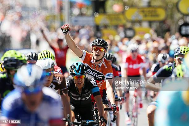 Australian cyclist and race winner, Rohan Dennis of the BMC Racing team celebrates as he finishes the race to win the overall classification after...