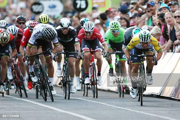 Australian cyclist Caleb Ewan of the Orica Scott team edges out Slovakian cyclist Peter Sagan of the Bora Hansgrohe team to win the People's Choice...