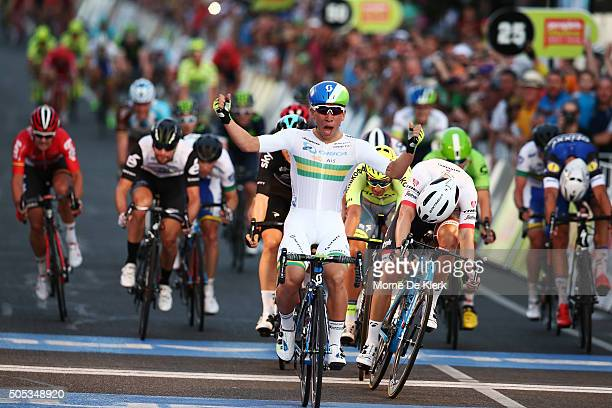 Australian cyclist Caleb Ewan of the OricaGreenEdge Team celebrates after winning the People's Choice Classic a preview race to the 2016 Tour Down...