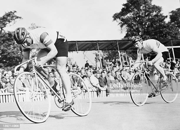 Australian cyclist Charles Bazzano is followed by Reg Harris of Great Britain at the start of the 1000 metres sprint semifinal second leg at the...