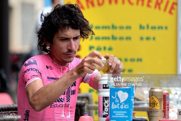 Australian cyclist Lachlan Morton takes a break during the 13th day of his solo alternative Tour de France cycling race in Tarascon-sur-Ariege on...
