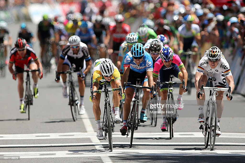 Australian cyclist Simon Gerrans of Orica GreenEDGE edges out German cyclist Andre Greipel of the Lotto-Belisol Team to win stage one of the Tour Down Under on January 21, 2014 in Adelaide, Australia.