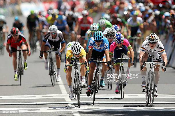 Australian cyclist Simon Gerrans of Orica GreenEDGE edges out German cyclist Andre Greipel of the LottoBelisol Team to win stage one of the Tour Down...