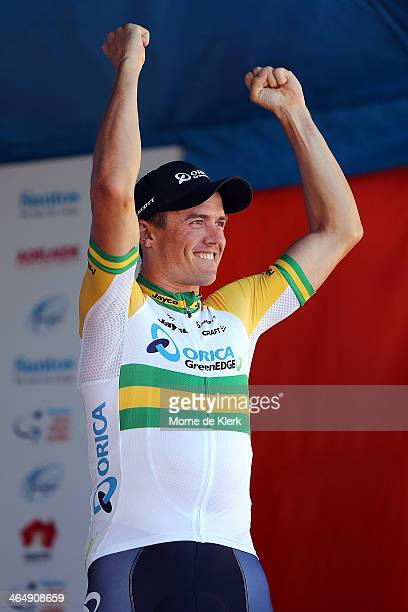 Australian cyclist Simon Gerrans of the Orica GreenEDGE team celebrates before being presented with the leaders Ochre Jersey after Stage Five of the...