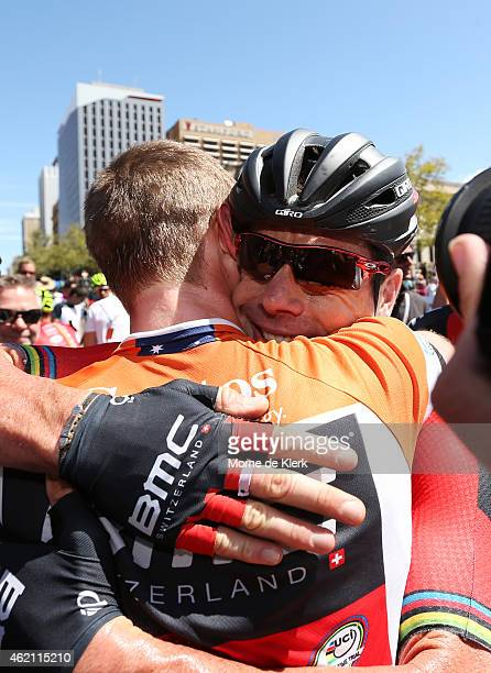 Australian cyclists of the BMC Racing Team, Cadel Evans and Rohan Dennis celebrate after Stage 6 of the 2015 Santos Tour Down Under on January 25,...