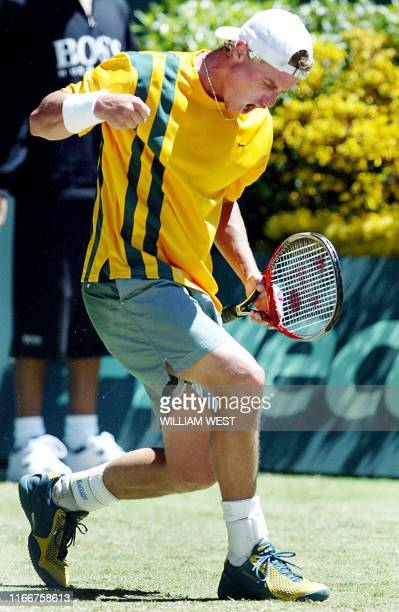 Australian Davis Cup player Lleyton Hewitt celebrates on the way to defeating Spain's Juan Carlos Ferrero in the Davis Cup final being played in...