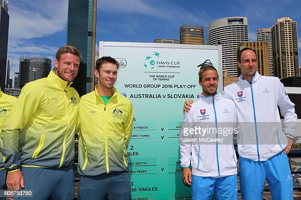 Australian Davis Cup players Sam Groth and John Peers pose with Andrej Martin and Igor Zelenay of Slovakia during the Davis Cup World Group Playoff...