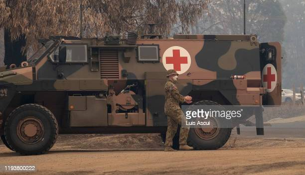 Australian Defence Force personal take a break after arriving in Mallacoota on January 15 Australia The Princes Highway between Mallacoota and Orbost...