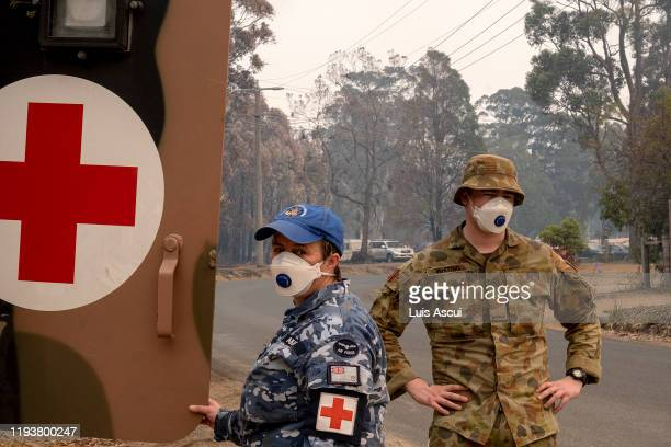 Australian Defence Force personal wear a mask while working in Mallacoota on January 15 Australia The Princes Highway between Mallacoota and Orbost...