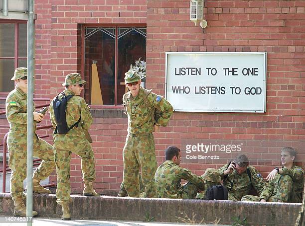 Australian Defence Force personel wait at the ready in case the city becomes inundated due to the potential levee breach of the Murrumbidgee River on...