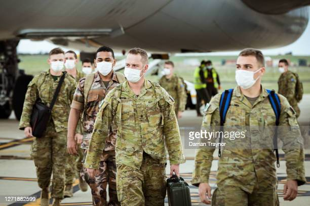 Australian Defence Force troops disembark an Australian Air Force plane at Avalon Airport on September 11, 2020 in Avalon, Australia. Australian...