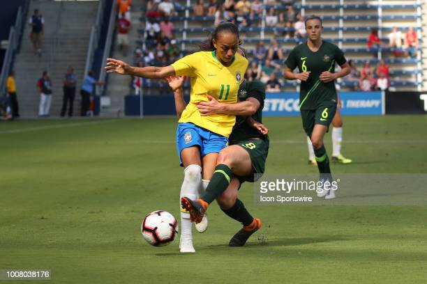 Australian defender Elise KellondKnight wraps up Brazil forward Adriana in the second half of a women's soccer match between Brazil and Australia in...