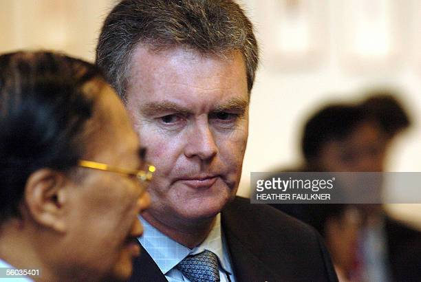 Australian delegate Duncan Lewis listens to an Asian delegate during a break in the highlevel AsiaPacific Economic Cooperation forum on Avian and...