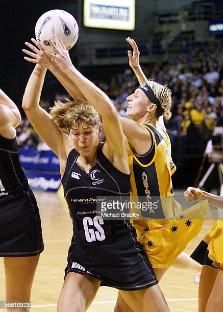 Australian Demelza Fellowes and Silver Fern Irene Van Dyk compete for the ball during the first Fisher and Paykel netball test between the Silver...
