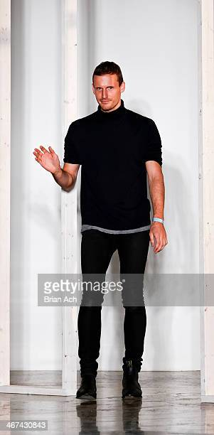 Australian designer Dion Lee appears on the runway at the Dion Lee fashion show during MADE Fashion Week Fall 2014 at Milk Studios on February 6 2014...