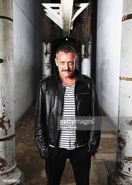 Australian designer Jayson Brunsden poses for a portrait ahead of MercedesBenz Fashion Week Australia 2014 on April 5 2014 in Sydney Australia...